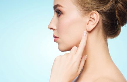 woman pointing to earlobe