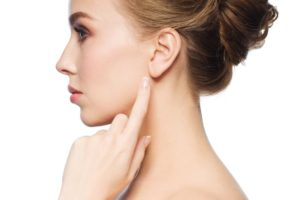 Your facial plastic surgeon in Chicago will repair your earlobes.